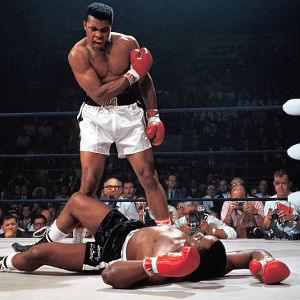Muhammad Ali in action after first round knockout of Sonny Liston at St. Dominic's Arena. Cover. Lewiston, ME 5/25/1965. CREDIT: Neil Leifer